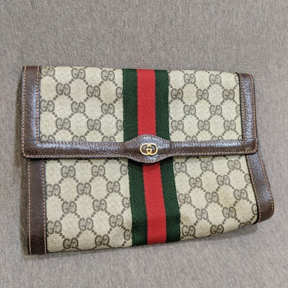 b1d12470d76 Gucci Handbags - Ophidia clutch bag